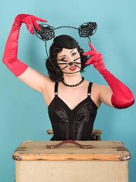 Vintage style lady with cat nose make up wearing some long red satin gloves